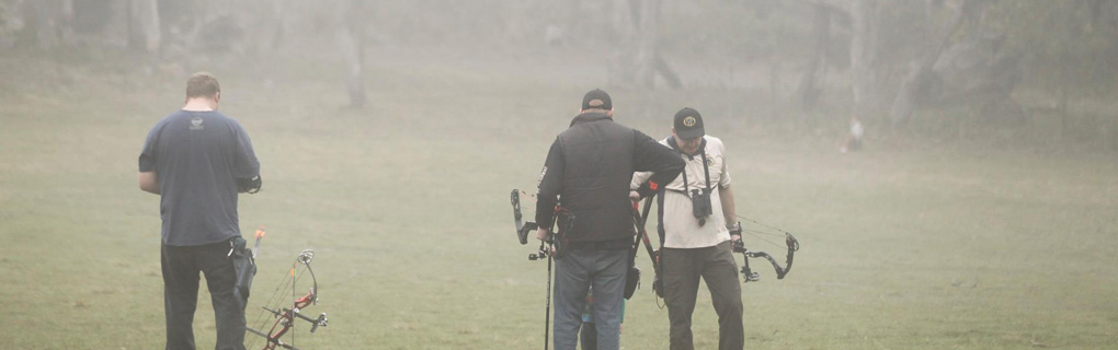 Archers: Carl Haynes, Jay Moylan, & Brendan Lazarus participating in a 3d shoot after the clouds came in